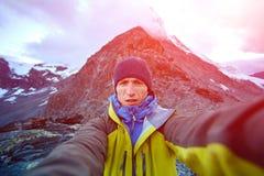 Hiker at the top of a pass Stock Photos