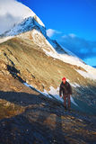 Hiker at the top of a pass with Matterhorn mount on background Royalty Free Stock Images