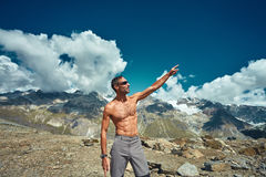 Hiker at the top of a pass royalty free stock photo