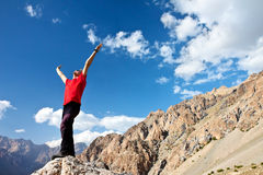 Hiker at the top of a rock Stock Images