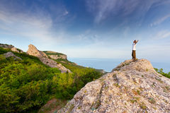 Hiker at the top of a rock Stock Photo