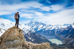 Hiker at the top of a rock with backpack Stock Photography