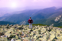 Hiker at the top of a rock with backpack enjoy sunny day. Hiker at the top of a rock with backpack enjoy sunny day Royalty Free Stock Photos