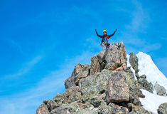 Hiker at the top of a rock Royalty Free Stock Image