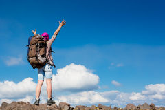 Hiker at the top of a rock with her hands up Royalty Free Stock Photo