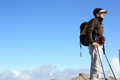 Hiker on top of Swiss alps. Hiker ready to move forward in a Swiss alps Royalty Free Stock Photography