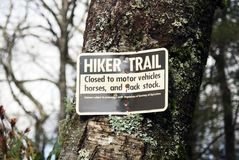 Hiker trail sign. Sign to designate a legal hiking area royalty free stock photo