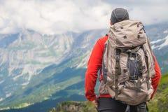Hiker traveling in Alps. Alpine peaks landskape background. Jungfrau, Bernese highland. Sport, tourism and hiking stock images