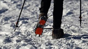 Hiker on the trek equipped with crampons Royalty Free Stock Photos