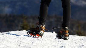 Hiker on the trek equipped with crampons Stock Photos