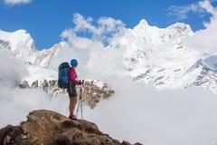 Hiker on the trek in Himalayas, Annapurna valley, Nepal royalty free stock photos
