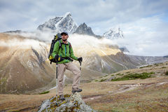Hiker on the trek in Himalayas, Khumbu valley Stock Photo