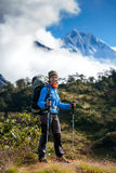 Hiker on the trek in Himalayas, Khumbu valley, Nepal Stock Photos