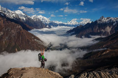 Hiker on the trek in Himalayas Stock Photos
