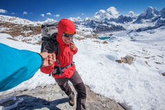 Hiker on the trek in Himalayas, Royalty Free Stock Images