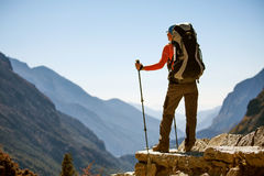 Hiker on the trek in Himalayas Royalty Free Stock Photo