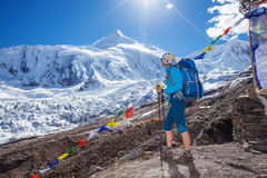 Hiker on the trek in Himalayas Stock Image