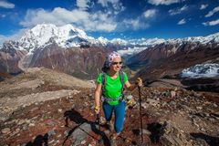 Hiker on the trek in Himalayas Stock Images