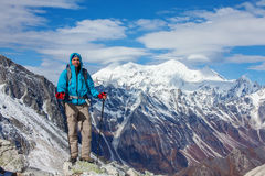 Hiker on the trek in Himalayas Royalty Free Stock Photography