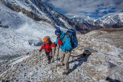 Hiker on the trek in Himalayas Stock Photo