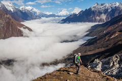 Hiker on the trek in Himalayas. Manaslu region, Nepal Royalty Free Stock Image