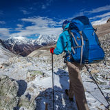 Hiker on the trek in Himalayas, Nepal Royalty Free Stock Image