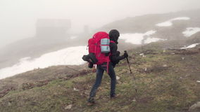 Hiker trekking through the fog slow motion stock footage