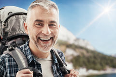 Hiker trekking on the mountains Royalty Free Stock Image