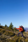 Hiker trekking in the mountains. Stock Images