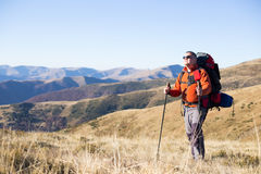 Hiker trekking in the mountains. Royalty Free Stock Images