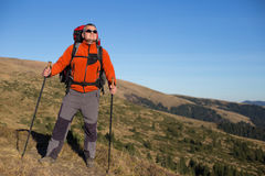 Hiker trekking in the mountains. Royalty Free Stock Photography