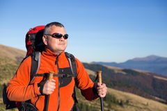 Hiker trekking in the mountains. Stock Image