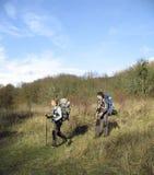 Hiker trekking in the mountains. Stock Photos