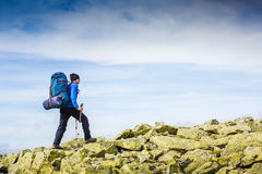 Hiker trekking in the mountains. Sport and active life Stock Photo