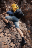 Hiker trekking in the mountains Stock Photo