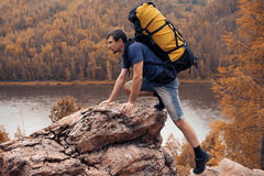 Hiker trekking in the mountains. Hiker trekking up in the mountains Royalty Free Stock Photo