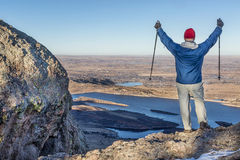 Hiker with trekking poles. A male hiker with trekking poles overlooking Horsetooth Reservoir from Arthur's Rock near Fort Collins, Colorado, a typical winter Stock Images