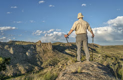 Hiker with trekking poles. Male hiker with trekking poles overlooking a mountain valley in northern Colorado - Poudre River North Fork above Halligan Reservoir Royalty Free Stock Photography