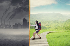 Hiker try to save polluted city royalty free illustration