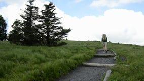 Hiker Turning Corner Uphill stock video