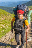 Hiker with two large backpacks Royalty Free Stock Image