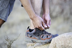 Hiker Tying Shoelaces. Asian Hiker Tying Shoelaces Outdoor Stock Photo