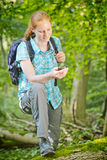 Hiker Using GPS Navigation in a Forest Royalty Free Stock Photography