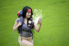 Hiker using internet connection with smartphone Stock Photography