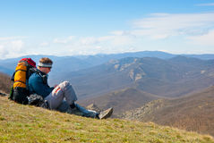 Hiker using mobile device Stock Photos