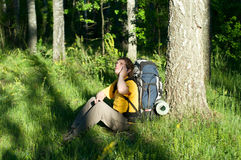 Hiker using mobile device. Royalty Free Stock Image