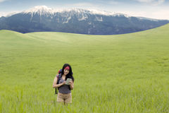 Hiker using smartphone at mountain Royalty Free Stock Images