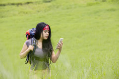 Hiker using smartphone for navigation Stock Photos