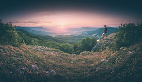 Hiker in a valley. Instagram stylisation. Hiker standing on a hill and enjoying the sunset in a Crimea mountain valley. Instagram stylisation Royalty Free Stock Images