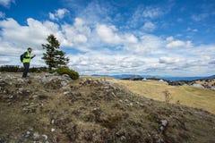 Hiker on Velika planina Royalty Free Stock Image